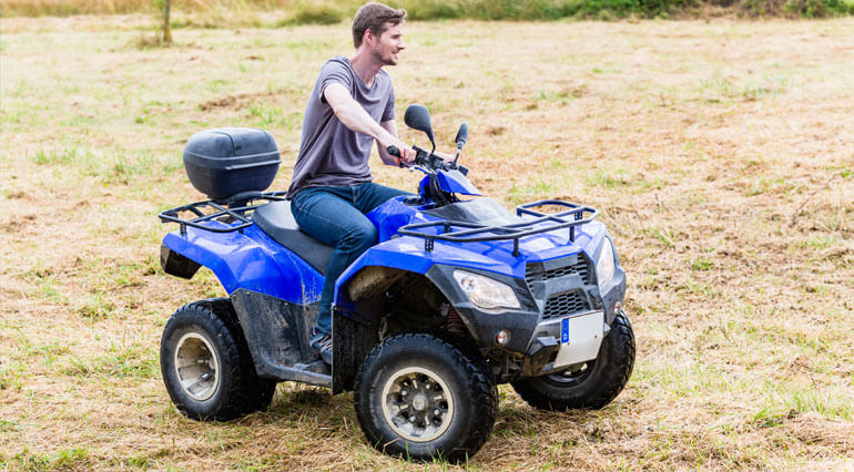 blue atv with a person riding it and having fun